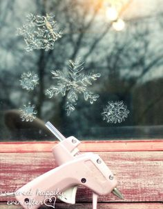 Use a hot glue gun to make window snowflakes 50 Essential Christmas Hacks, Tips, And Tricks To Help You Survive The Holidays Diy Christmas Decorations Easy, Christmas Hacks, Noel Christmas, Christmas Projects, All Things Christmas, Winter Christmas, Holiday Crafts, Holiday Fun, Christmas Ornaments