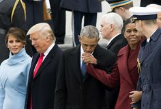The Painfully Sweet President Barack Obama Moment You Probably Missed from the Inauguration kissing First Lady Michelle Obama hand.