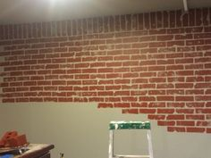 Faux brick wall in progress. Painted wall grey, then used dollar store car washing sponges to sponge on the red. Valspar wet pavement for base and French quarter for brick color. Painted Brick Walls, Faux Brick Walls, Diy Wand, Faux Murs, Diy Wall Painting, Brick Colors, Wall Treatments, Paint Designs, Decoration