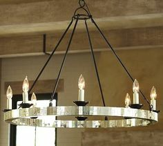 $479. I'd like cooler light bulbs, but this one works because it's a traditional shape.  The black rods feel industrial, and the mirrors give it some bling.  In fact, that would make it coordinate well with the finsh and shape of the ceiling lamps in the 2 bedrooms.  Parsons Mirrored Chandelier #potterybarn
