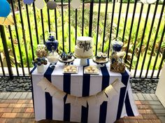 Fancy, boy baby shower. Navy gold and white.  Tablecloth is from target (it's actually a shower curtain, but no one could tell). The banner is also from target. Candy from party city. The jars & cake stands are from homegoods (we changed the ribbon to match the theme). The cake name is from JennandJulesDesigns from etsy.  I bought some meringues from publix and spray painted them gold with edible spray paint from Michael's, it was very easy and everyone loved them .