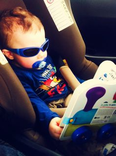 "#Cool #baby #boy with #sunglasses and #pacifier , on a car seat, going to visit his grandparents! If he could speak his line would be ""Don't disturb me when I'm reading #books!"""