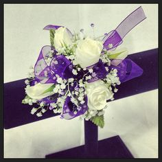 Wrist corsage with white roses, purple ribbon & lavender rhinestones.