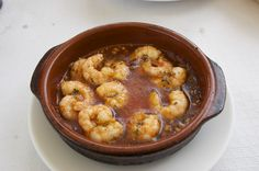 Delicious Gamba's pil pil.  For more information about Andalusian food and other great Andalusian stuff visit our Facebook page: www.facebook.com/laestrelladecompeta