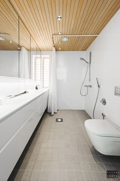 White bathroom with custom cabinetry