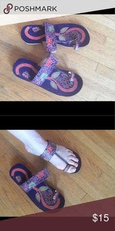 Tibetan Flip Flops Brand new! I bought a bunch of these as gifts for people at a store in Brooklyn. I ended up with an extra pair somehow so that's why they are on here. The colors are gorgeous and pop out even when you wear them. Also these sandals are really comfy. The best part is the heal is made out of wood, it's made out of a combo of squishy materials. That means your step is cushioned and your heals are also happy when you walk. Handmade in Tibet  Shoes Sandals