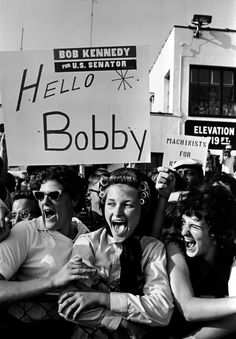 "Cornell Capa © International Center of Photography USA. Upstate New York. 1964. Supporters of Robert KENNEDY give a new definition to ""Bobby Soxers"" during his Senate campaign."