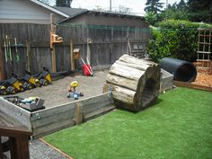 Very cool sandbox, like the garden utensils hanging on the wall, and wheelbarrow, and birdhouses, and tunnel.