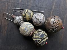 Rustic artisan earrings with three polymer clay beads by fancifuldevices.