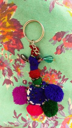 Handcrafted with 4 wool pom poms, miror and different colored/sized beads. Many uses including keyring, zipper pull, keychain, BOHO Chic Bag Charms. As the product is handcrafted each keyring is unique. Pom Poms, Arts And Crafts, Charmed, Personalized Items, Bag, Unique Jewelry, Handmade Gifts, Etsy, Vintage