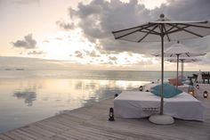 The Luxury Dhigu Resort, Maldives. you HAVE to click on this link and see all of the gorgeous pictures. I'd love to go here
