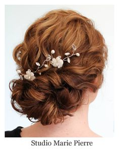 Romantic bridal hair, twisted curl low updo with hair pins, hairstyle by Studio Marie Pierre.