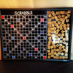 Homemade magnetic Scrabble board for the wall.