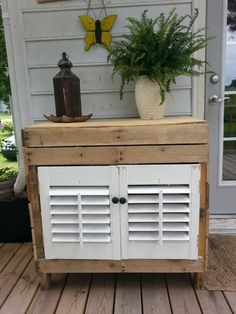 Pallet wood cabinet with recycled window shutters. I would love this cabinet painted and antiqued for my small space in laundry room.