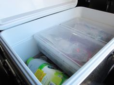 How to keep food dry while camping. Container Store plastic boxes + Coleman Steel Belted cooler. The boxes rest perfectly on an internal ledge in the cooler. They also keep the food organized and dirt-free on the camp table.