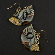 2 Roses Steampunk Polymer Clay Earrings  These earrings combine steampunk style with elements of art deco and art nouveau. Yeah, we know, th...