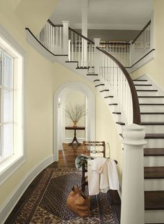 Yellow paint color scheme for hallways and entryways from Benjamin Moore. Cream 2159-60 upstairs is AF-155 weimeraner