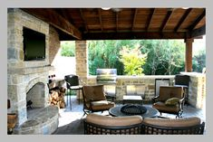 A great layout with covered seating area, fireplace and tv, with bbq and cooking space.