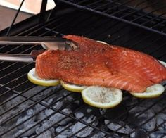 Grill fish on a bed of lemon slices to infuse with flavor and keep fish from sticking to the grill.