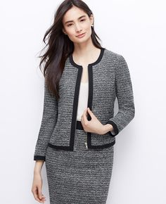 "Timeless tweed gets an urban update with black trim and an Exposed zip front, for newly defined feminine style. Jewel neck. 3/4 sleeves. Exposed zip front. Patch pockets. Lined. 20 1/2"" long."