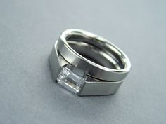 White Sapphire Engagement Ring Set - Titanium Tension-Set and Wedding Band - Satin Finish with Emerald Cut Sapphire by herstellerrings.com