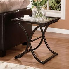 With these sophisticated glass end tables in your living room or study, your existing decor will be complemented by a touch of distressed elegance. The tempered glass surface and metal frame make a sturdy resting place for your favorite lamp or vase.