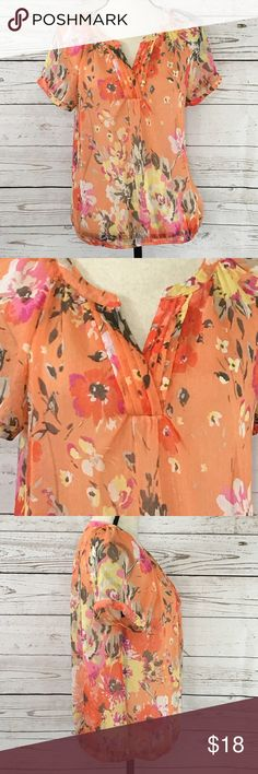 """St. John's Floral Semi-Sheer Peasant Style Top Pretty peach floral, semi-sheer, v-neck, short sleeve blouse with an elastic waistband. Excellent used condition. Bust: 40""""; length in the back from the shoulder to the bottom hem: 24"""". Measurements are approximate. Smoke free home. 🌺Thank you for shopping my closet 😊🌺 St. John's Bay Tops Blouses"""