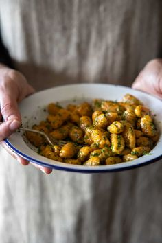 Vegan Sweet Potato Gnocchi by The Minimalist Vegan. This recipe for vegan gnocchi is simple, delicious and home cooking at its best. You'll create fluffy, soft and pillowy little dumplings that can be paired with your favourite sauce. #vegangnocchi #sweetpotatognocchi #vegansweetpotatognocchi #veganitalianrecipes