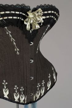 I'm sewing my way through every corset pattern in Norah Waugh's book, Corsets and Crinolines. People do this sort of thing with cookbooks, why not a book of patterns?