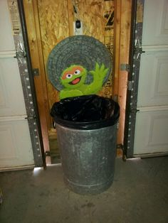 Sesame Street party - Oscar wall decoration. Great if you have a grey garbage can lying around.