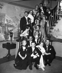 A staircase full of Hollywood, including: Marion Davies, Douglas Fairbanks, Jr., Douglas Fairbanks, Sr., Clark Gable, Carole Lombard and Clifton Webb.
