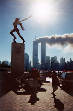 September 11 - photo from New Jersey. The statue & the burning tower make an interesting contrast.
