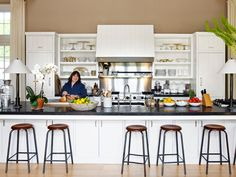 Ina Garten, leave often-used appliances out, has soapstone countertops, and seems to have an easy-flow work space