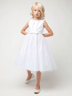 White Pleated Satin w/ Bow Tulle Dress Style: Sleeveless pleated satin bodice Irremovable waistband w/ center bow Double layer tulle overlay skirt Zipper back closure w/ satin tie back sash Crinoline layer & lining within Tea length Made in the Little Girl Dresses, Girls Dresses, Flower Girl Dresses, Flower Girls, Girls Communion Dresses, White Sleeveless Dress, Christening Gowns, Ivory Dresses, Tulle Dress