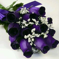 Purple roses I once said that they didn't have purple:-)But when I got to work there they were:-):-)