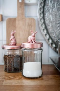 OH MY GOODNESS! What a fantastic idea! Glue plastic toys to the top of jars and spray paint the lids and toys copper for an instant cute and classy look.