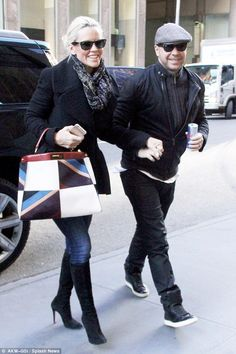 Angry: The former Playboy pinup and actress, pictured with husband Donnie Wahlberg Tuesday in New York, revealed she'd had to sign a disclosure about her health including cold sores before filming the guest slots