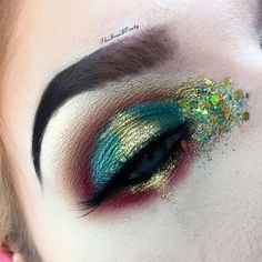 ❌Christmas Party❌ An up close shot of my look from my collaboration with @bangtsikitsiki. Go check out her page for details on her look! @meltcosmetics Lovesick, Blur and Unseen. @morphebrushes 35U palette. @sugarpill Goldilux. @shineshack Gold Leaf glitter. @starcrushedminerals Golden Ticket glitter. @eylureofficial @vegas_nay Grand Glamor lashes.  @anastasiabeverlyhills dip brow pomade in medium brown. @nyxcosmetics Chocolate Micro Brow Pencil.