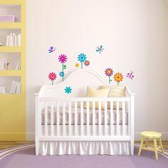 vinilos decorativos con flores para colocar en habitación de bebe.