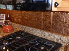 Possibly...Pressed Copper Kitchen Backsplash Tiles...I have this & just love it !!