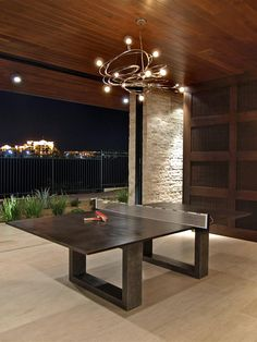 Now THIS is what I need!  A Ping Pong Dining Table! Check out the light fixture!  Check out the house!  Yes, I need all of this!