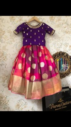 kurta for namakarna and annaprasana tradational wear designs by Angalakruthi boutique Bangalore Kids party wear designs kurta designs dress wear Indian Dresses For Kids, Kids Indian Wear, Kids Ethnic Wear, Dresses Kids Girl, Kids Outfits, Baby Dresses, Indian Clothes, Kids Dress Wear, Kids Gown