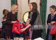 Camilla Duchess of Cornwall, patron of the Helen & Douglas House and The London Taxidrivers' Fund invites underprivileged children from both charities to decorate the Christmas tree and join the Duchess for Christmas lunch at Clarence House on December 15, 2015 in London, England.