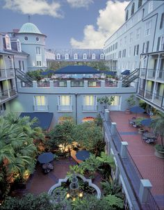 Daytime aerial view of the Royal Sonesta Hotel New Orleans (Stay on the 3rd floor and the patio doors open to the pool and courtyard area, http://www.sonesta.com/RoyalNewOrleans/.  Also, the Restaurant Revolution is in that hotel.  Folse's new place.