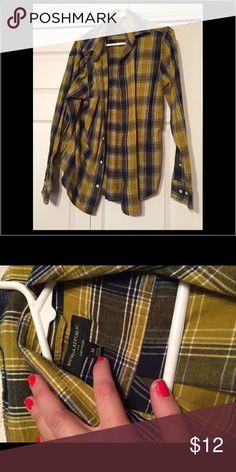 Plaid button down long sleeve Yellow and navy plaid button down long sleeve. Men's medium from Banana Republic. Super comfortable! Banana Republic Shirts Casual Button Down Shirts