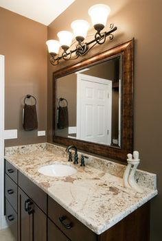 This combination of bathroom cabinets, countertop, and mirror achieves elegance and timelessness.