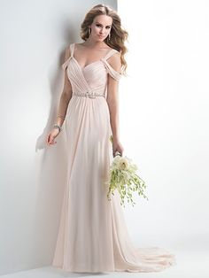 Maggie Sottero - JUNE, Grecian sheath gown of Arlo chiffon, accented with sweetheart neckline and draped cold shoulder sleeves. Twinkling Swarovski crystals adorn the waistband and trail a zipper and inner elastic back closure.