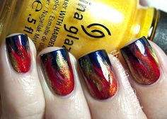 Hunger Games Girl on Fire nail art. Nails. Manicure. Fire.