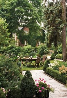 English garden. love the structured hedge borders. Wish there was a boxwood hardy enough for our climate.