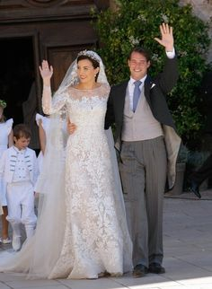 royalwatcher:  Religious wedding of Prince Felix of Luxembourg and Claire Lademacher, now Princess Claire of Luxembourg, France, September 21, 2013-the couple following the ceremony